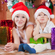 Little boy and mother in Santa hat — Stock Photo #6874942