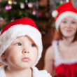 Little boy in Christmas hat — Stock Photo #6874945