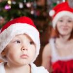 Little boy in Christmas hat — Stock Photo #6874945