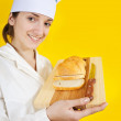 Girl in chef uniform holding slice bread — Stock Photo #6874998