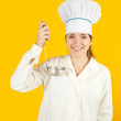 Woman in chef uniform tasting from ladle — Stock Photo