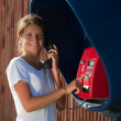 Girl on the pay phone — Stock Photo