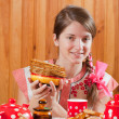 Girl in traditional  clothes with pancake — Stock Photo