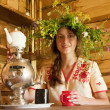 Girl having tea from   russian samovar — Stock Photo