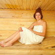 Royalty-Free Stock Photo: Girl sits  in  sauna