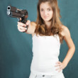 Girl aiming a black gun — Stock Photo #6875061