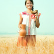 Girl with bread at rye field — Stock Photo #6875062