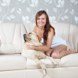 Stock Photo: Mid adult woman with labrador