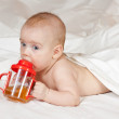 Baby girl with sippy cup — Stock Photo #6875481