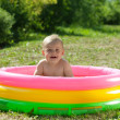 Happy baby swimming in pool — Stock Photo #6875485