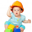 Toddler in hardhat plays  with  blocks — Stock Photo