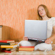 Stock Photo: Girl with laptop and books