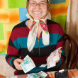 Happy senior woman with money — Stock Photo