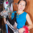 Mature woman thinking at wardrobe — Foto de Stock