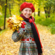 Elderly woman in autumn park — Stock Photo #6875626