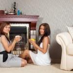 Women near the fireplace — Stock Photo #6875709