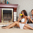 Women near the electric fire — Stock Photo #6875711