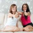 Stock Photo: Happy mid adult women showing thumb up