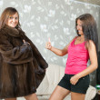 Woman shows new fur coat — Stock Photo