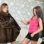Woman shows new fur coat — Stock Photo