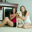 Two mid adult women with labrador — Stock Photo