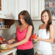 Stock Photo: Women cooking at them kitchen