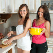 Stock Photo: Two women cooking at kitchen
