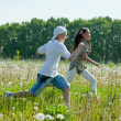 Royalty-Free Stock Photo: Teens runs at meadow