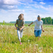 Royalty-Free Stock Photo: Friends running at meadow