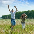 Teenagers jumping at meadow — Stock Photo