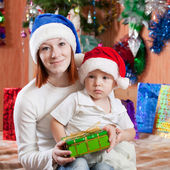 Mother and baby with Christmas gift — Stock Photo