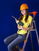 Female worker with drill — Stock Photo