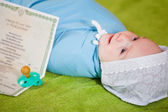 Baby with certificate of birth — Stock Photo