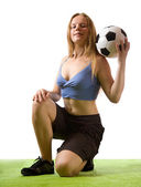 Girl posing with soccer ball — Stock Photo