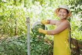 Gardener composting grass — Stock Photo