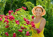 Happy gardener in roses plant — Stock Photo