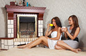 Women near the electric fire — Stock Photo