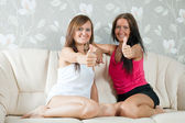 Happy mid adult women showing thumb up — Stock Photo