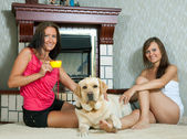 Women with labrador in home — Stock Photo