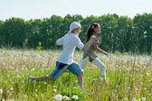 Teens runs at meadow — Stock Photo