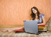 Relaxed girl with laptop — Stock Photo