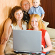 Family using a laptop — Stock Photo