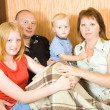 Family sitting in living room — Stock Photo #7557844