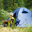 Female hiker near camp tent — Stock Photo