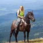 Rider on horseback at mountains — Stock Photo #7559866