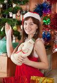 Girl near fir-tree at home — Stock Photo