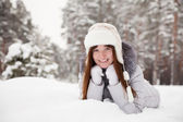Happy girl lying on snow — Stock Photo