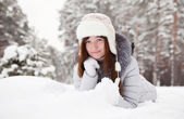 Girl lying down on the snow — Stock Photo