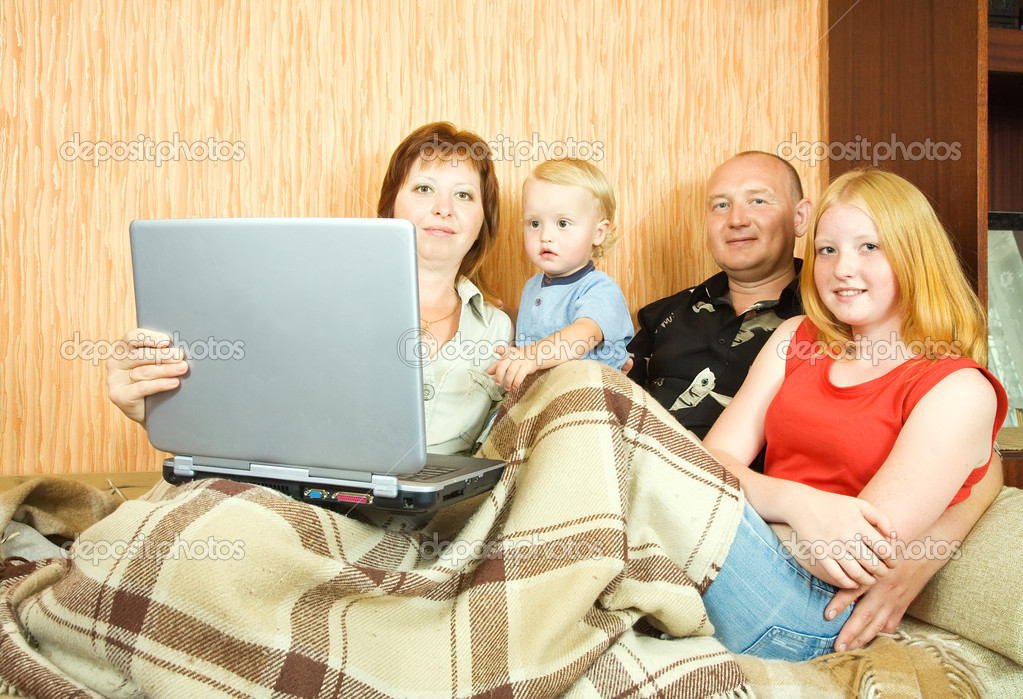 Young family shopping online in the living-room — Stock Photo #7557849