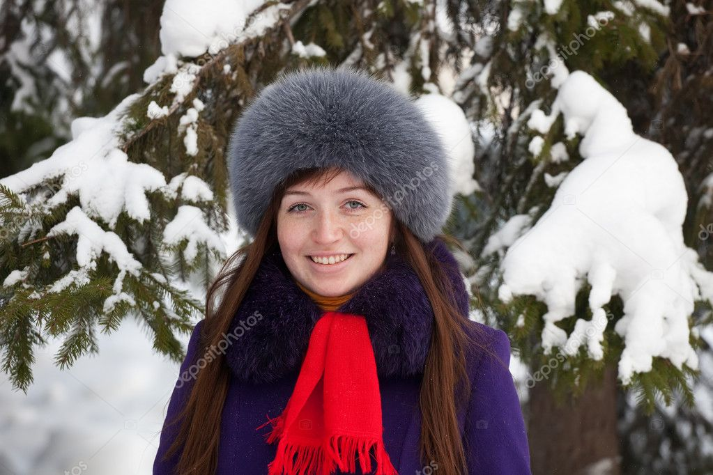 Portrait of beautiful woman in coat and fur cap — Stock Photo #7559713